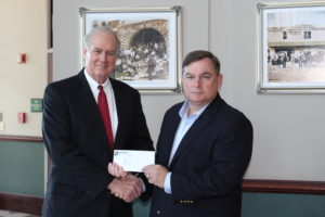 Baldwin EMC District 1 Trustee Chad Grace (right) presents Baldwin EMC's tax payment to Bay Minette Mayor Robert Wills.