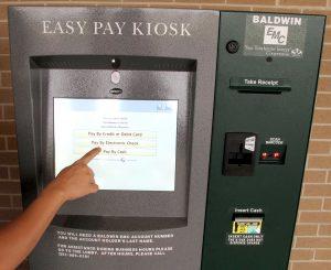Hand at Kiosk