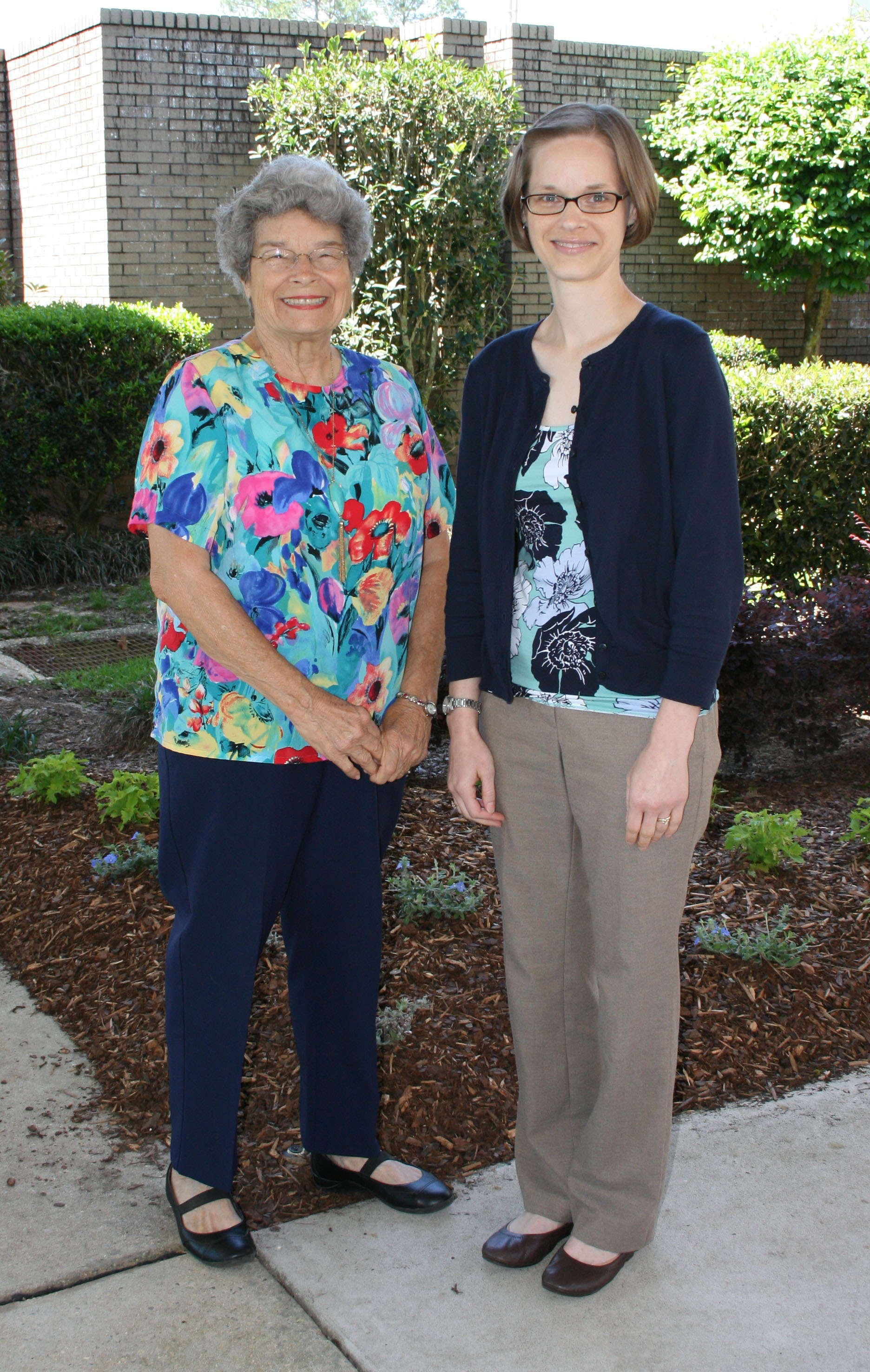 Baldwin EMC retiree Lois Schneider sits down with employee Jessica Johnson