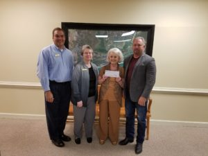 Baldwin EMC District 4 Trustee Tommie Werneth (second from right) presents Baldwin EMC's tax payment to (l-r) Orange Beach City Administrator Ken Grimes, Finance Director Clara Myers and Mayor Tony Kennon.