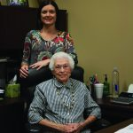 Baldwin EMC retiree Georgia McLain sits down with employee Shelby Singleton